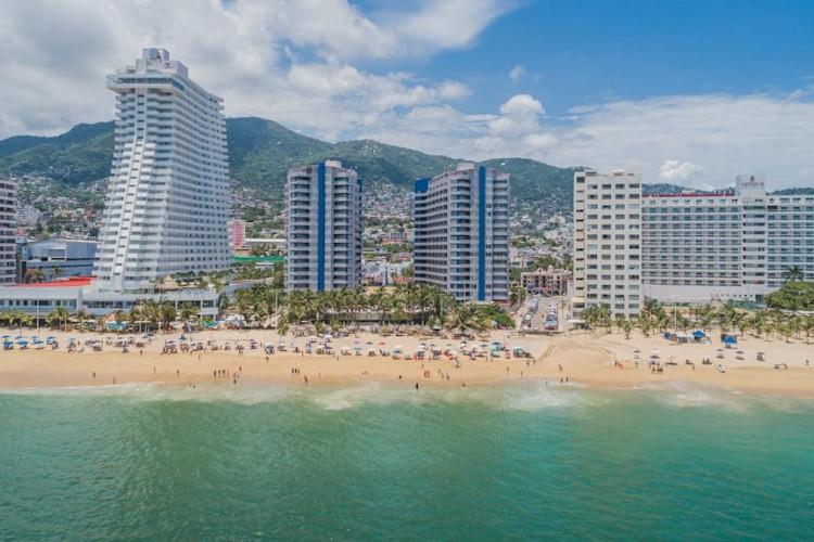 Image principale de l'hôtel Playa Suites offert par VosVacances.ca