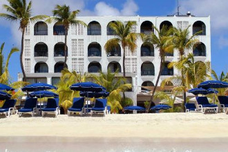 Main image of the Holland House Beach Hotel offered by YourVacations.ca